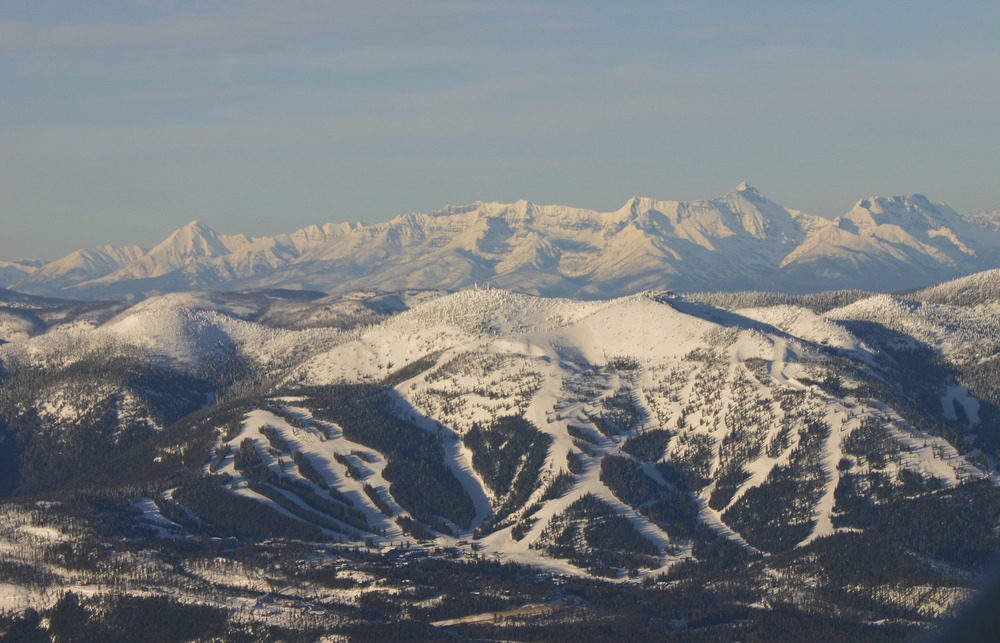 Whitefish Mountain Resort sits adjacent to Glacier National Park (background) in Northwest Montana. Photo: Whitefish Mountain Resort