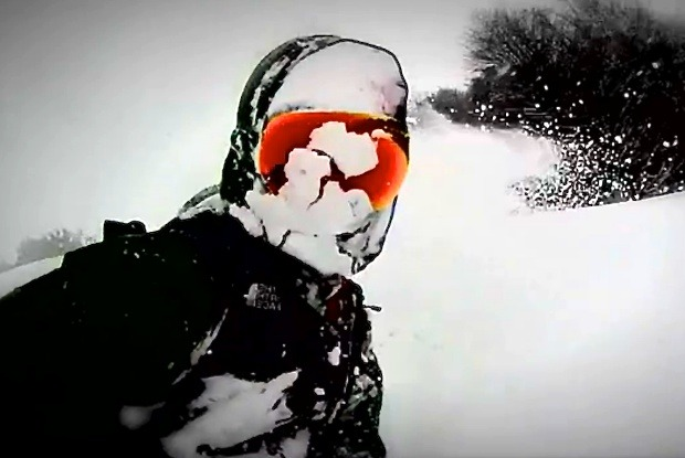 Andrew Burns gets a face full of powder during a favorite run at Cerro Catedral.