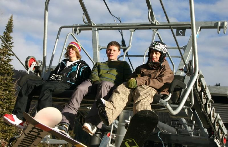 Snowboarders in a chairlift at Solitude Mountain Resort, Utah