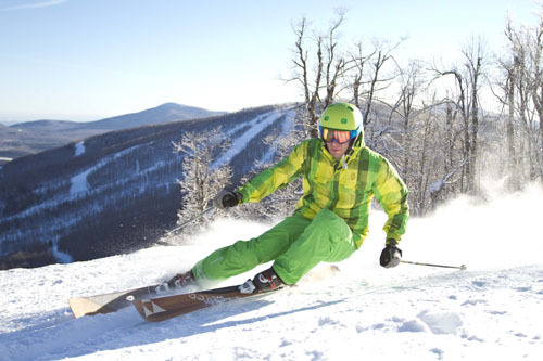 A skier carves deep turns on a perfect day at Windham. Photo Courtesy of Windham Mountain.