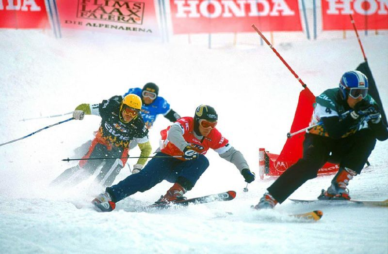 Skiers in the midst of a race competition in Laax.