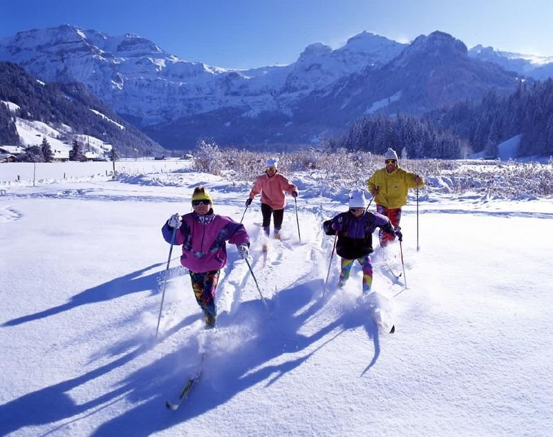 A family of crosscountry skiers in Lenk, SUI.