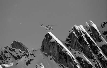 The chopper high above the peaks at Mica Heli-Skiing.