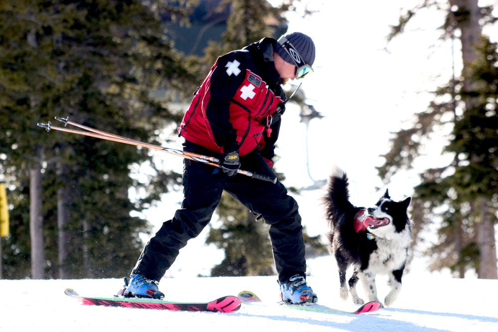 Keystone, Colorado Ski Patroller Lloyd Morsett and Teton the avalanche dog.