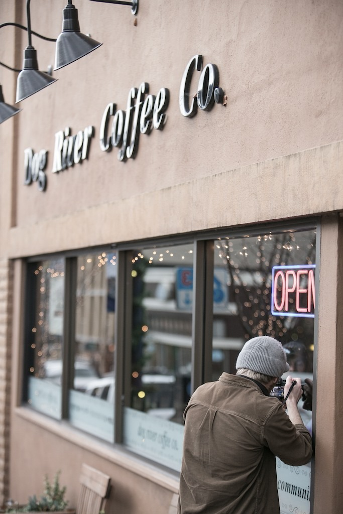 Videographer Mike Hagadorn gets a shot through the window at Dog River Coffee in Hood River, Oregon.