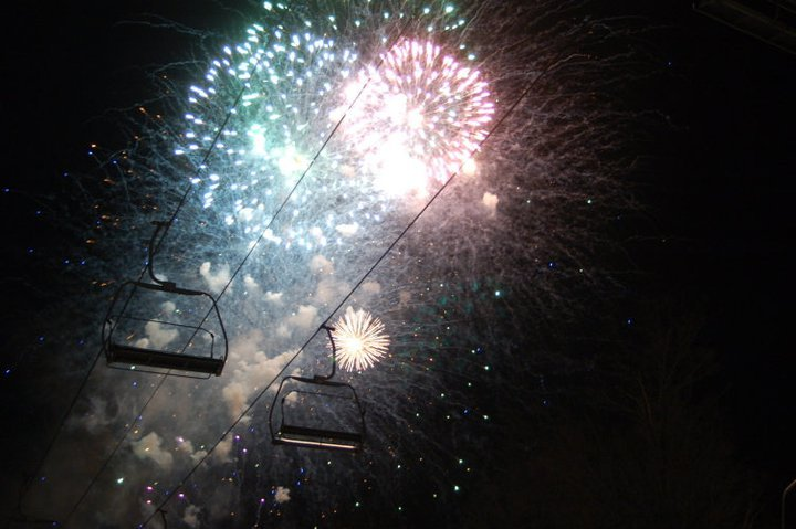 Chairlifts silhouetted by fireworks at Okemo. Photo Courtesy of Okemo Mountain Resort.
