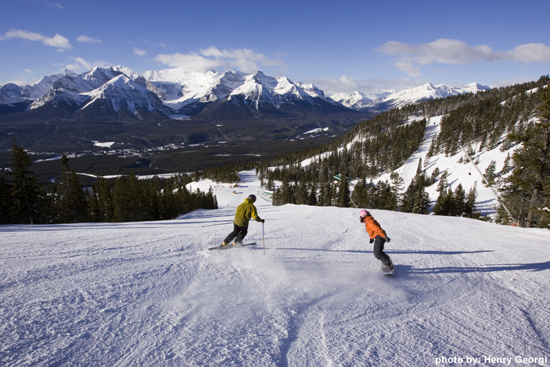 Snowboarders descend a groomer at Lake Louise. Photo by Henry Georgi.