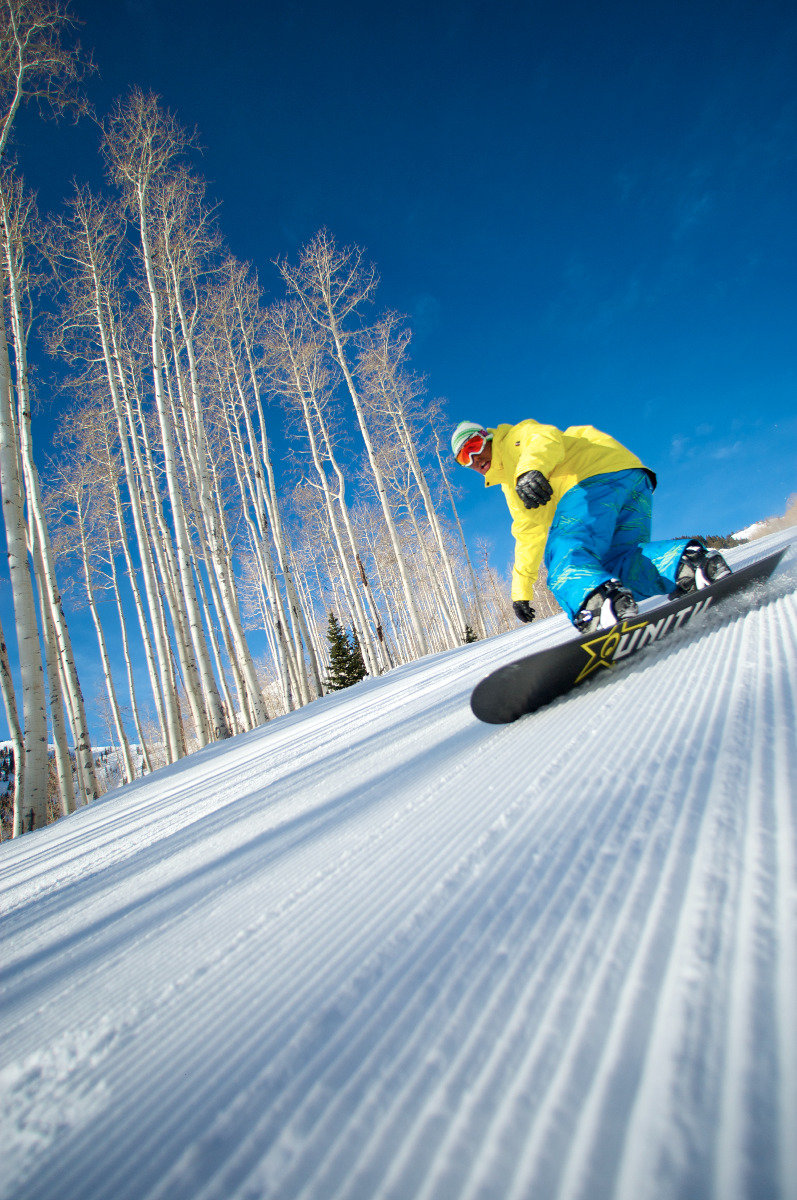 Ripping the fresh corduroy at Canyons Resort - ©Courtesy of Canyons Resort; Photographer, Rob Bossi