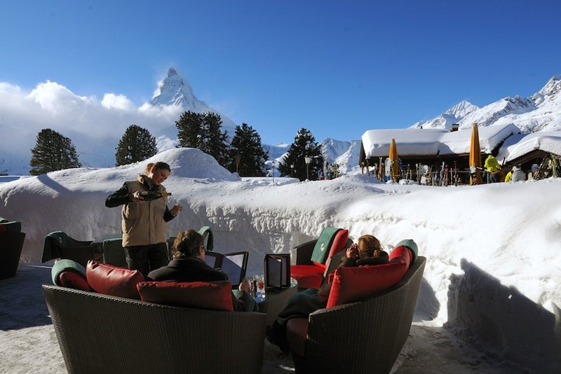 Lunchtime drinks next to the Matterhorn at the Riffelalp Resort, Zermatt
