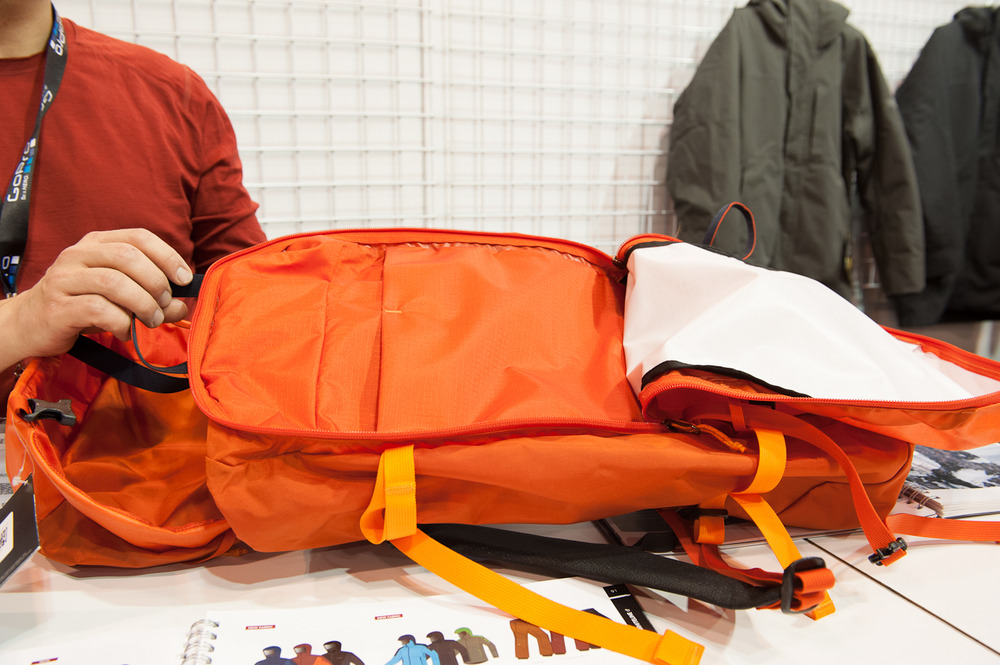 The Khamski Pack from Arc'teryx is a waterproof pack that is perfect for touring out into the backcountry. It features a large outside pocket, aluminum frame and has a volume of 48L while still remaining super lightweight.