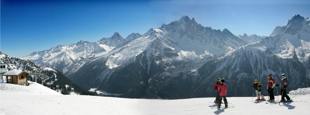 Skiing at Chamonix on La Flegère sector with panoramic view on the Aiguilles Vertes