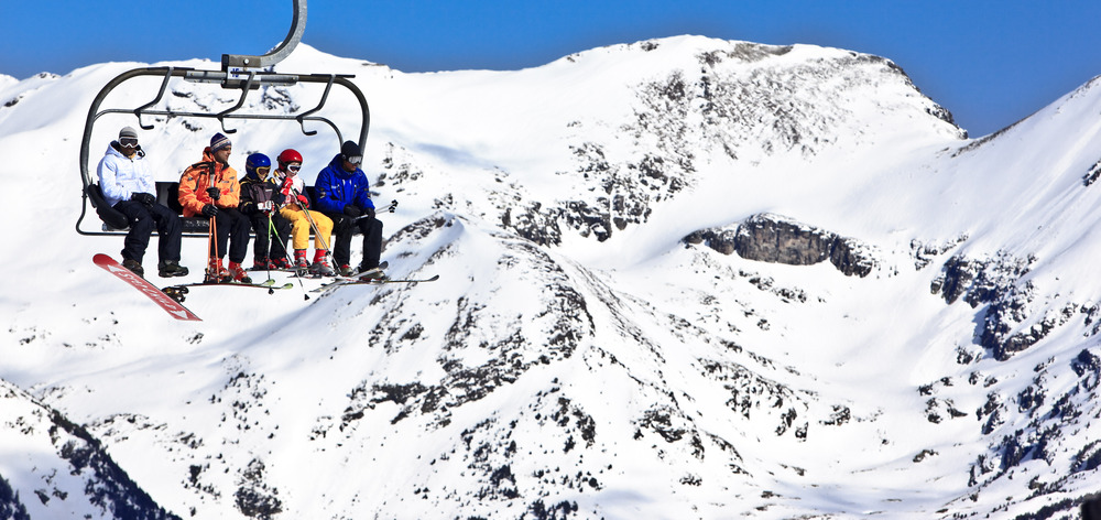Family taking a chairlift in Grandvalira, Andorra