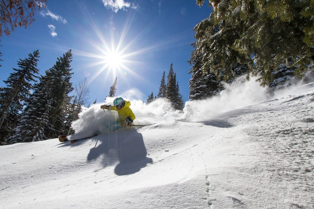 Kaylin Richardson enjoys fresh powder at Canyons in Park City, Utah. The resort averages 355 inches of snowfall a year and has 4,000 acres of skiable terrain - ©Liam Doran