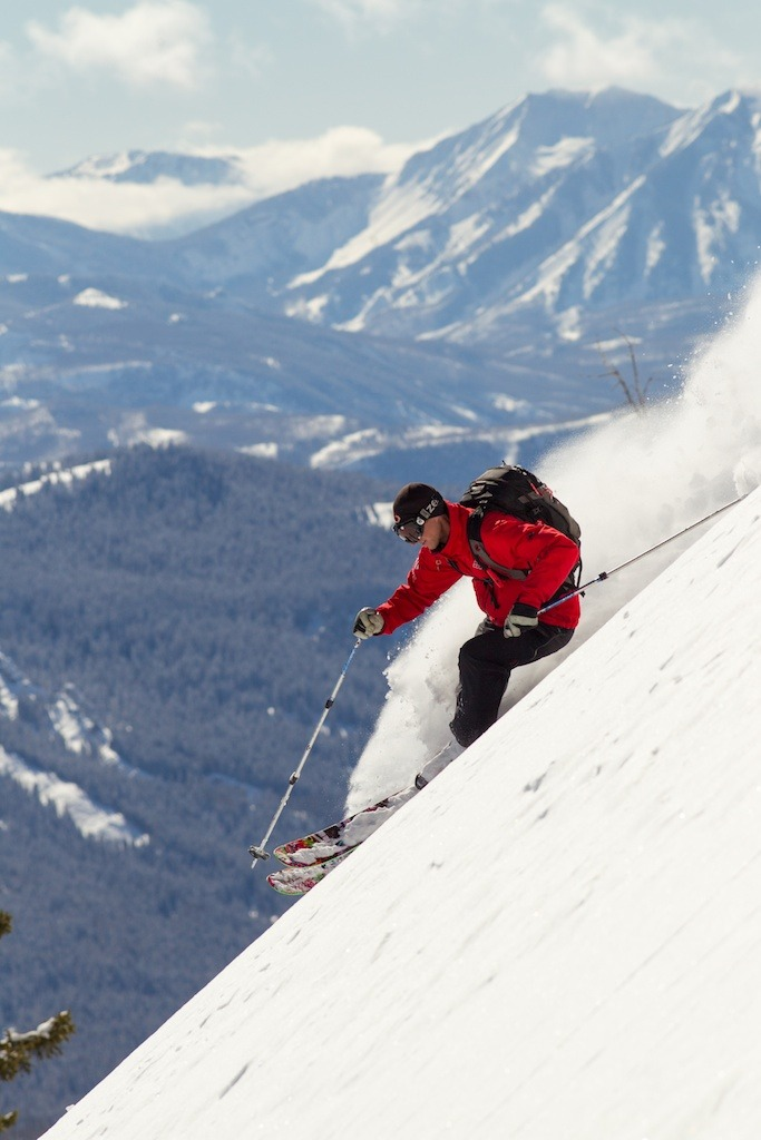 Lead Guide, Steve Banks of Irwin Cat Skiing at Eleven Colorado skis some deep powder.