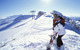 A snowboarding couple pause at the top of Schatzberg in Wildschönau AUT.