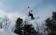 A skier gets air off a jump in the terrain park at Crotched Mountain, New Hampshire