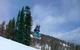 Kid snowboarder, Wesley Muresan on holy cow jump in snowpark at Sundown Mountain, Iowa.