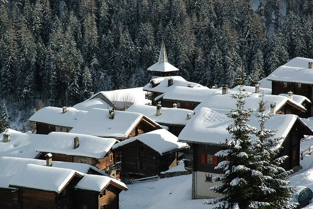 Snowy rooftops in picturesque Grimentz, Switzerland - ©Powder Heaven