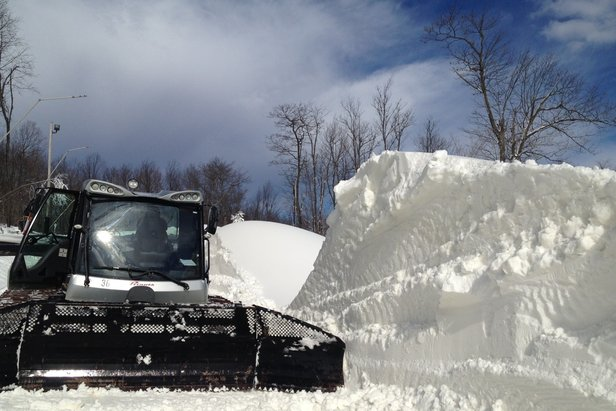 Snowcat rests next to drift at Seven Springs - ©Hidden Valley Resort