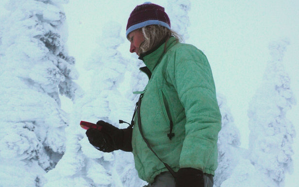 A skier practices with her beacon before going into the backcountry. - ©Becky Lomax