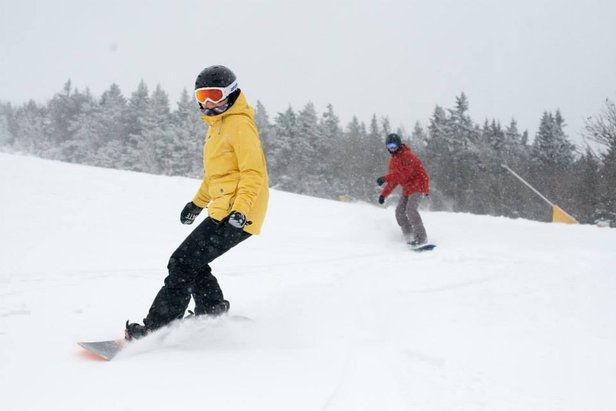 Snowboarders enjoy fresh powder at Stratton. - ©Stratton Mountain
