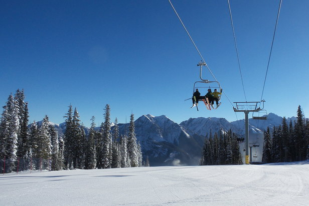 First chair at Nakiska reaches mid-mountain on opening day Nov. 15, 2014 . - ©Resorts of the Canadian Rockies