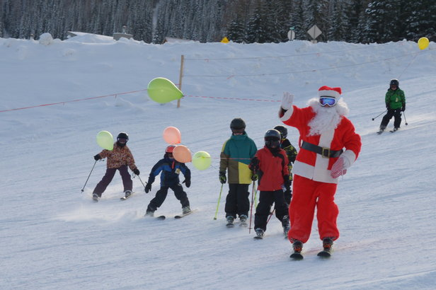 Santa skis with kids at Schweitzer Mountain Resort. - ©Schweitzer Mountain Resort
