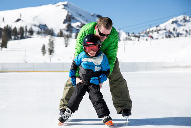 A family ice skates at Squaw Valley. - ©Jeff Curtes