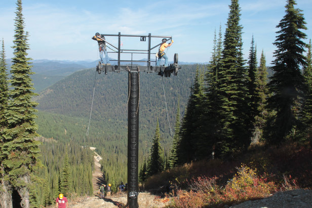 New Flower Point Chairlift at Whitefish Mountain Resort gets cross arms installed in preparation for winter 2014-15. - ©Whitefish Mountain Resort