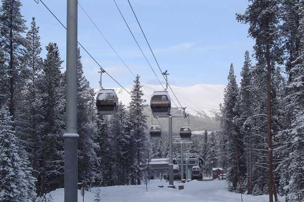 A gondola filled with passengers heads the mountain in Breckenridge, Colorado