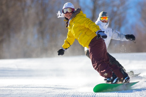 Snowboarders charge the lopes at Mount Sunapee. Photo Courtesy of Mount Sunapee.