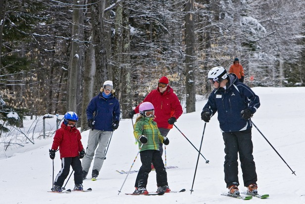 A family of skiers takes a group ski lesson at Whiteface Mountain. Photo Courtesy of ORDA/Dave Schmidt.