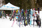 Dozens of pairs of skis awaiting you among the trees... ski testing does not suck. - Dozens of pairs of