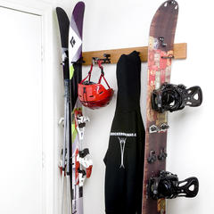 Wall-mounted ski rack for rocker gear. - ©Rocker Ski Rack
