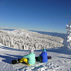 Snowboarders soak up the view at Mission Ridge's summit. Photo courtesy of Mission Ridge.