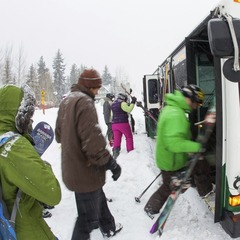 Locals load the bus on the way to the mountain