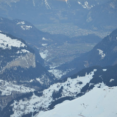 The view from the highest train station in Europe looks down at the start of the Downhill course, the town of Wengen on the ridge and the town of Interlaken over 10,000 vertical feet below.