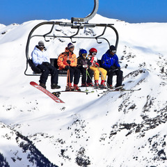 Family taking a chairlift in Grandvalira, Andorra - ©Marc Gasch/Grandvalira Tourism