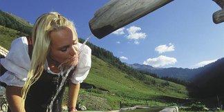 Frau am Brunnen - ©TVB Rauris