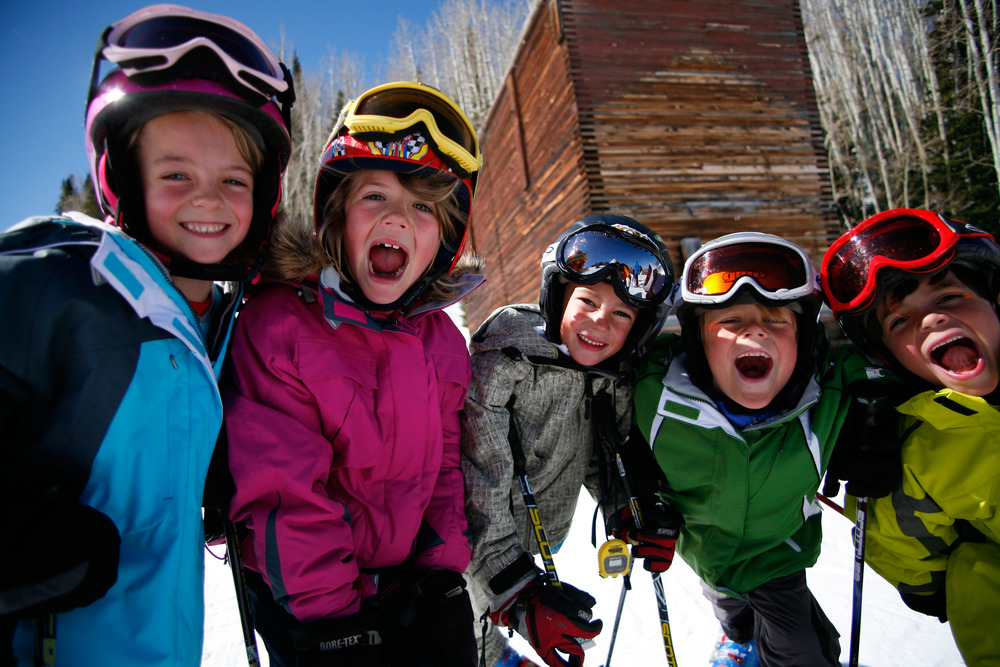 A group of kids take a photo at Park City Mountain Resort, Utah
