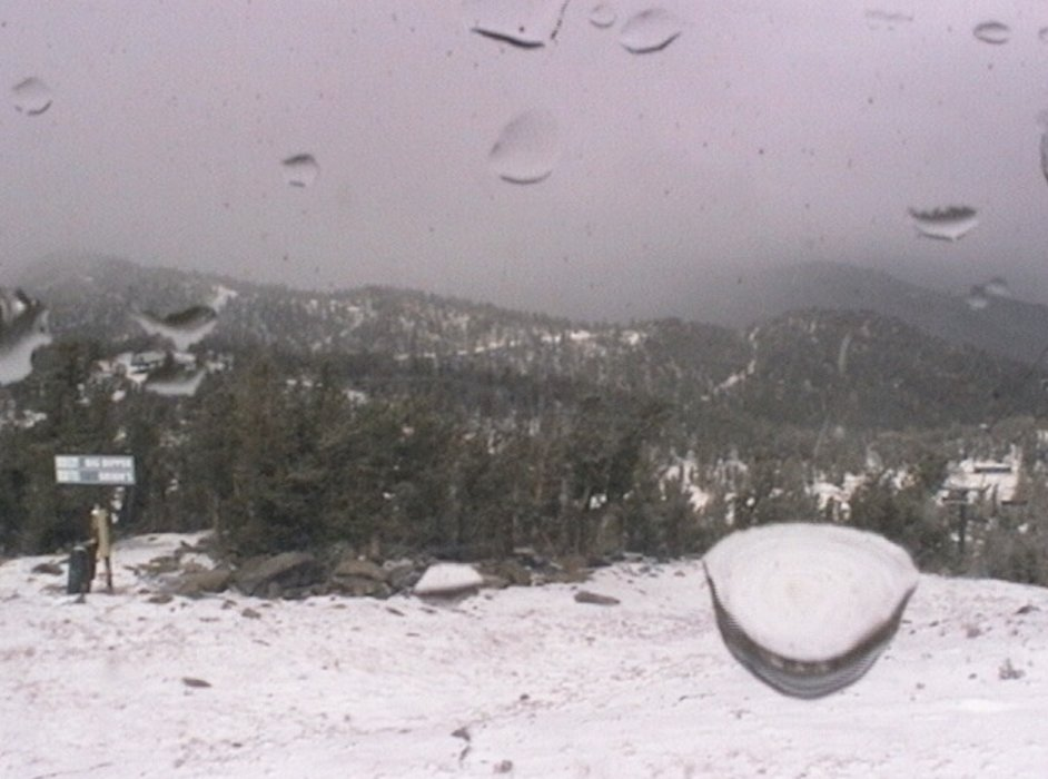 While raining at lake level, it began snowing at the top of Heavenly Mountain Resort. Photo from Heavenly's new snow stake and camera located near the top of Dipper Express. - © Heavenly Mountain Resort