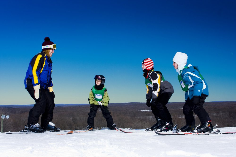 A group of kids recieve ski lessons in Shanty Creek, Michigan