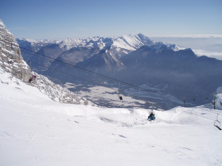 Looking down over the old 'Iron Curtain' divide when skiing from Kanin to Sella Nevea - © Sella Nevea Tourist Office