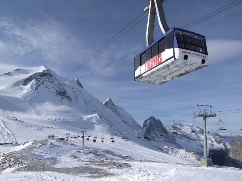 Taking the cable car up to Tignes' Grande Motte Glacier - © Tignes