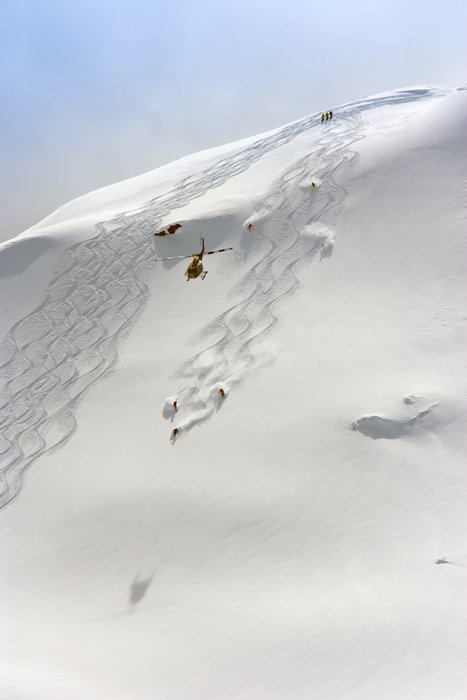 Skiers make their mark on one of the many open faces of British Columbia pristine powder.  - ©Sherri Harkin