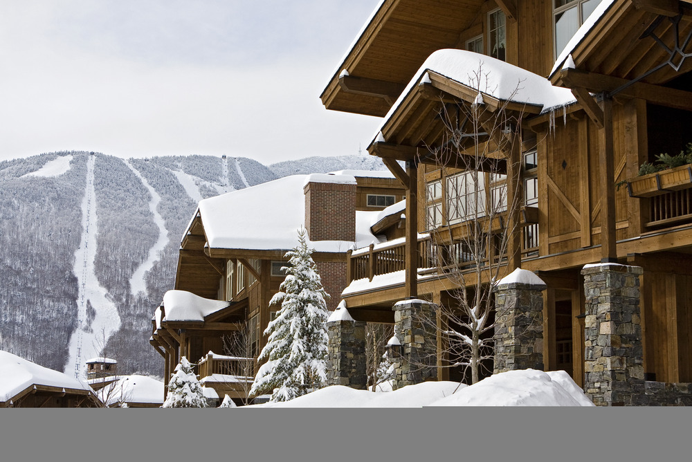 A scenic view of a lodge and mountain in Stowe, Vermont