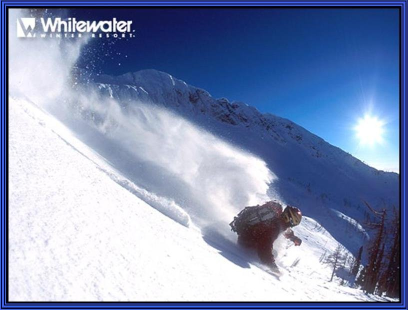 A skier in powder at Whitewater Ski Resort, British Columbia