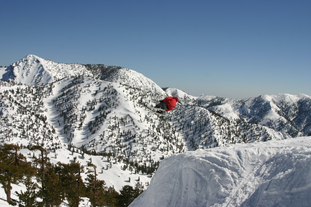 A skier gets air and a great view off a jump at Mt. Baldy Ski Resort, California