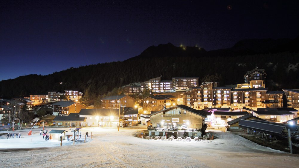 La Norma with its different residences by night - © Booking office La Norma