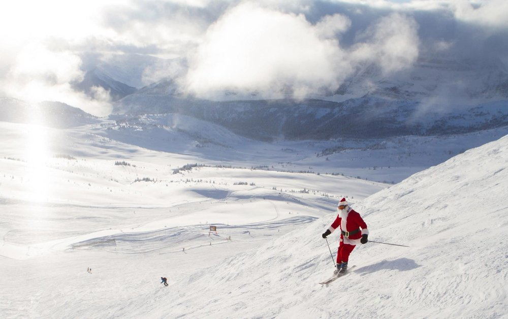 Santa making some turns in the big open bowl. - ©Sunshine Village Resort